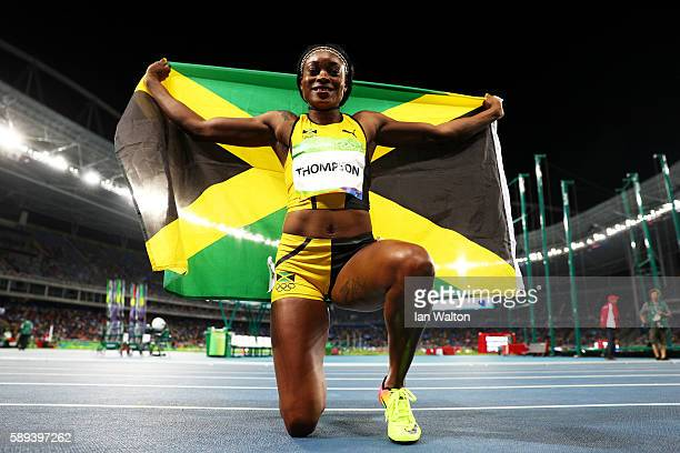 Elaine Thompson of Jamaica celebrates after winning the Women's 100m Final on Day 8 of the Rio 2016 Olympic Games at the Olympic Stadium on August 13...