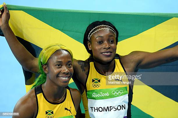 Elaine Thompson of Jamaica celebrates winning the Women's 100m Final with ShellyAnn FraserPryce of Jamaica on Day 8 of the Rio 2016 Olympic Games at...