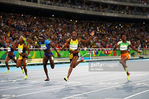 Elaine Thompson of Jamaica celebrates winning the Women's 100m Final ahead of Tori Bowie of the United States and ShellyAnn FraserPryce of Jamaica on...