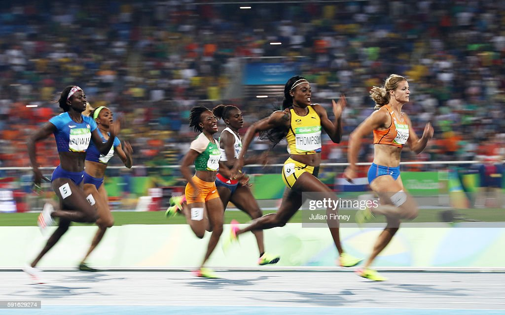 Elaine Thompson of Jamaica competes on her way to winning the gold medal in the Women's 200m Final ahead of Dafne Schippers of the Netherlands on Day...