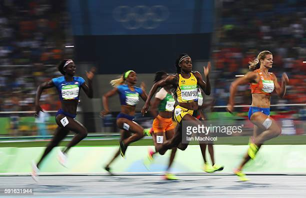 Elaine Thompson of Jamaica on her way to victory in the Women's 200m final on Day 12 of the Rio 2016 Olympic Games at the Olympic Stadium on August...