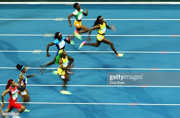 Elaine Thompson of Jamaica on her way to winning the Women's 100m Final on Day 8 of the Rio 2016 Olympic Games at the Olympic Stadium on August 13...