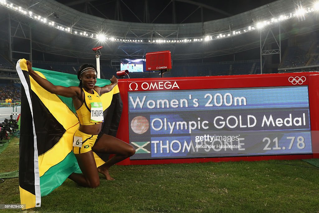 Elaine Thompson of Jamaica poses with her official time after winning the gold medal in the Women's 200m Final on Day 12 of the Rio 2016 Olympic...