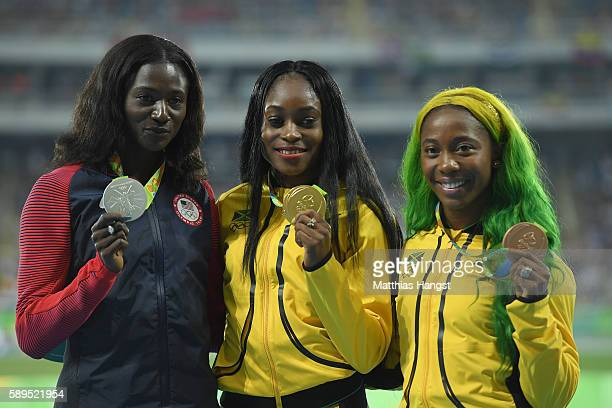 Elaine Thompson of Jamaica poses with the gold medal Tori Bowie of the United States silver medal and ShellyAnn FraserPryce of Jamaica bronze medal...