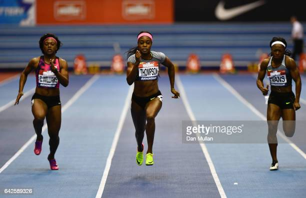 Elaine Thompson of Jamaica races to victory against Christania Williams of Jamaica and Gayon Evans of Jamaica in the Women's 60 metres final during...