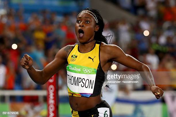 Elaine Thompson of Jamaica reacts as she wins the gold medal in the Women's 200m Final on Day 12 of the Rio 2016 Olympic Games at the Olympic Stadium...