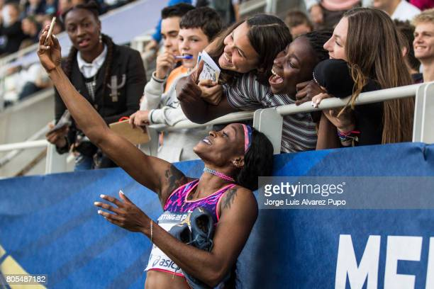 Elaine Thompson of Jamaica takes a selfie with some fans after the 100m women during Meeting de Paris of the IAAF Diamond League 2017 at Charlety...