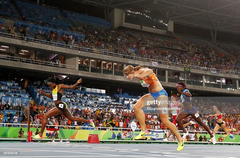 Elaine Thompson of Jamaica wins the gold medal in the Women's 200m Final ahead of Dafne Schippers of the Netherlands on Day 12 of the Rio 2016...