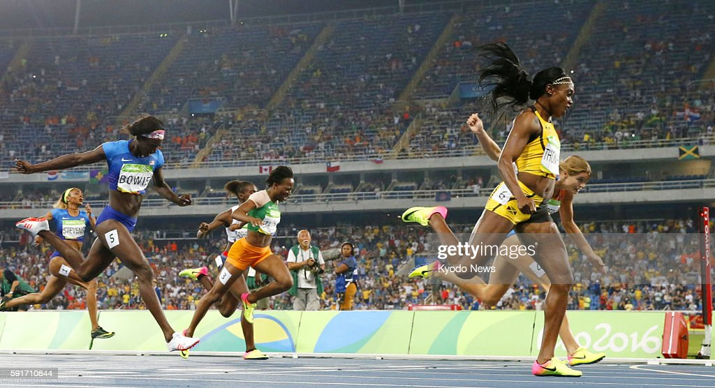 Elaine Thompson of Jamaica wins the women's 200meter gold medal ahead of silver medalist Dafne Schippers of the Netherlands and bronze medalist Tori...