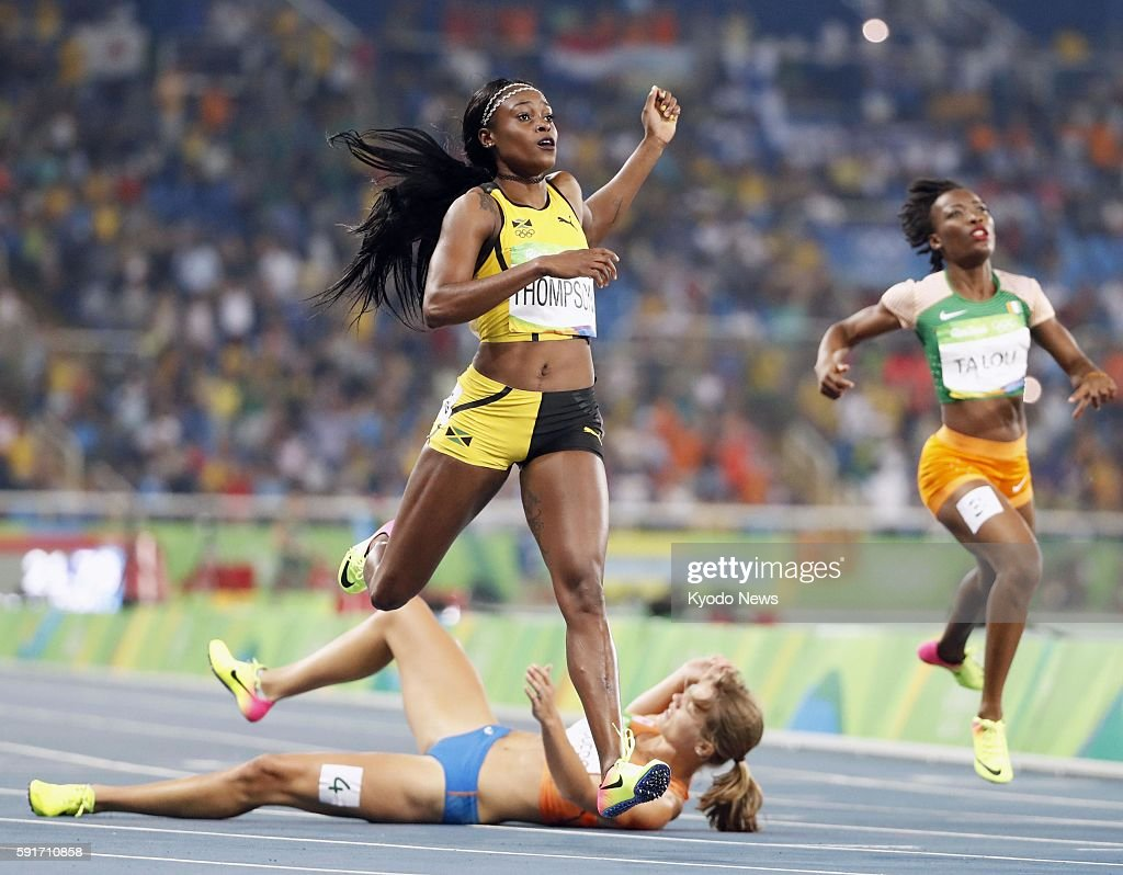 Elaine Thompson of Jamaica wins the women's 200meter gold medal ahead of silver medalist Dafne Schippers of the Netherlands at the Rio de Janeiro...