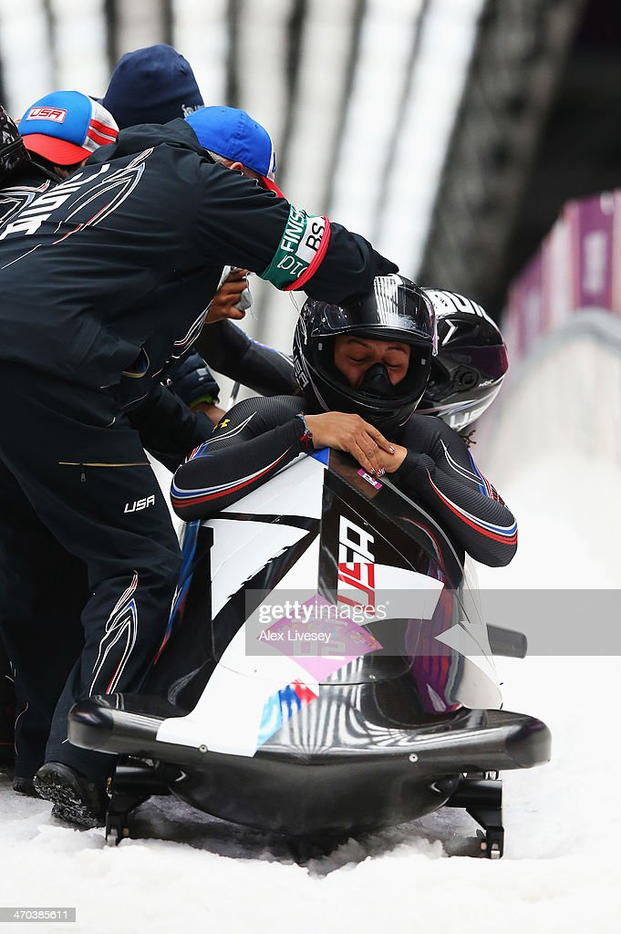 Elana Meyers and Lauryn Williams of the United States team 1 react after winning the silver medal during the Women's Bobsleigh on Day 12 of the Sochi...