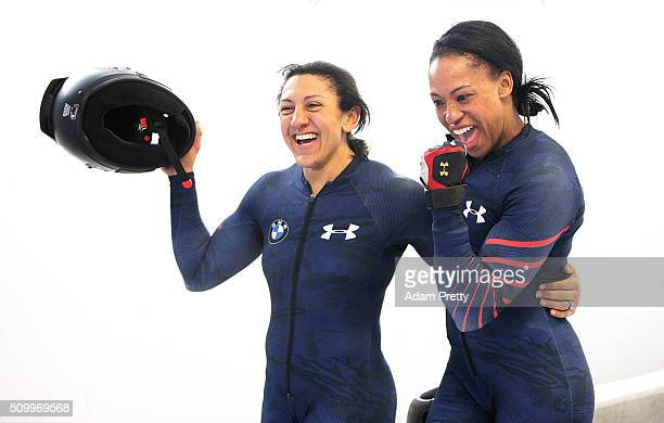 Elana Meyers Taylor and Lauren Gibbs of the USA celebrate third place after their fourth run in the Women's Bobsleigh during Day 2 of the IBSF World...