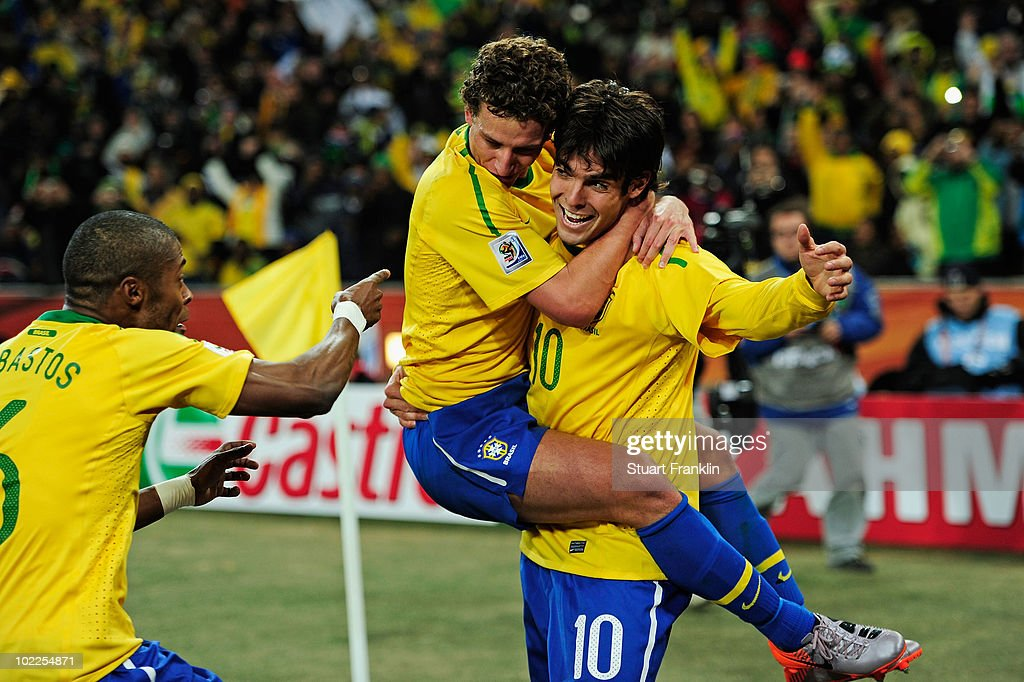 Elano of Brazil celebrates his goal with team mate Kaka during the 2010 FIFA World Cup South Africa Group G match between Brazil and Ivory Coast at Soccer City Stadium on June 20, 2010 in Johannesburg, South Africa.