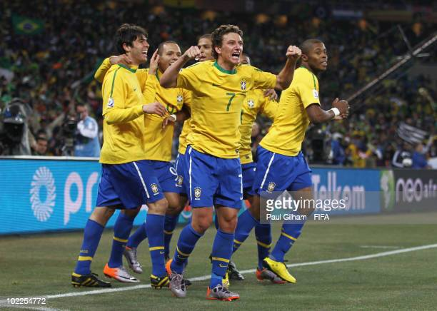 Elano of Brazil celebrates with team mates after scoring the third goal during the 2010 FIFA World Cup South Africa Group G match between Brazil and...
