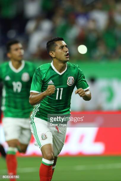 Elías Hernández of Mexico celebrates after scoring the opening goal of his team during the friendly match between Mexico and Ghana at NRG Stadium on...