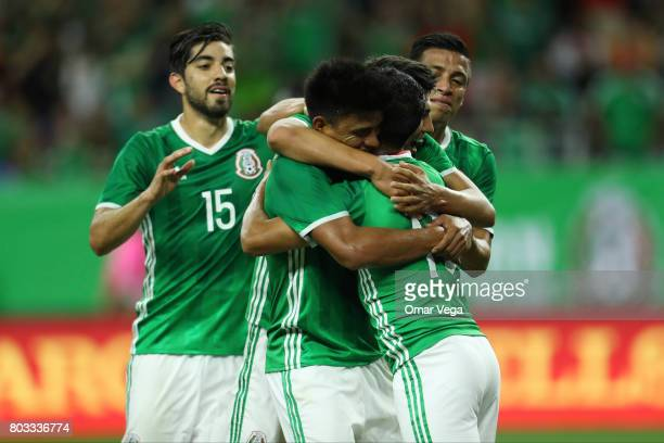Elías Hernández of Mexico celebrates with teammates Rodolfo Pizarro and Erick Gutierrez after scoring the opening goal of his team during the...