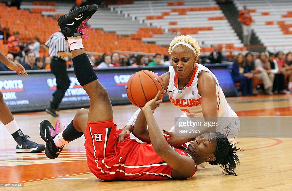 Elashier Hall #2 of the Syracuse Orange reaches for the ball on the court against Erica Wheeler #3 of the Rutgers Scarlet Knights during the game at the Carrier Dome on February 19, 2013 in Syracuse, New York.