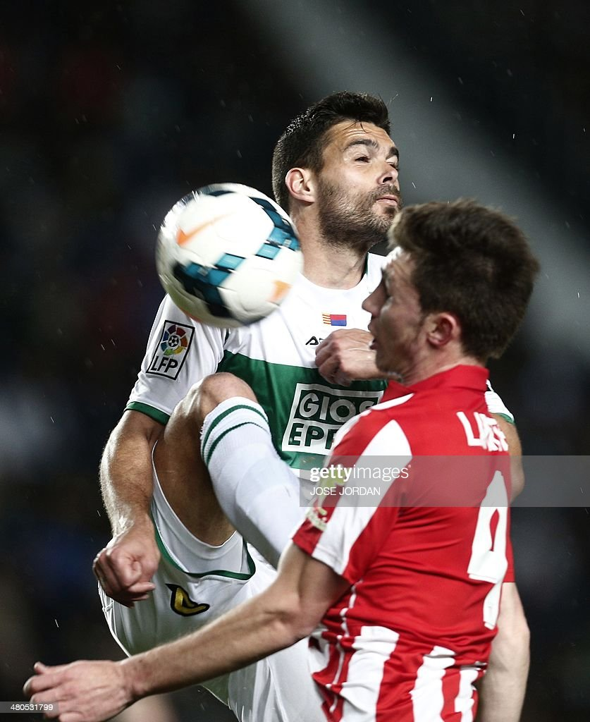 Elche's defender Botia (L) vies with Athletic Bilbao's French defender Aymeric Laporte during the Spanish league football match Elche CF vs Athletic Club Bilbao at the Martinez Valero stadium in Elche on March 25, 2014.