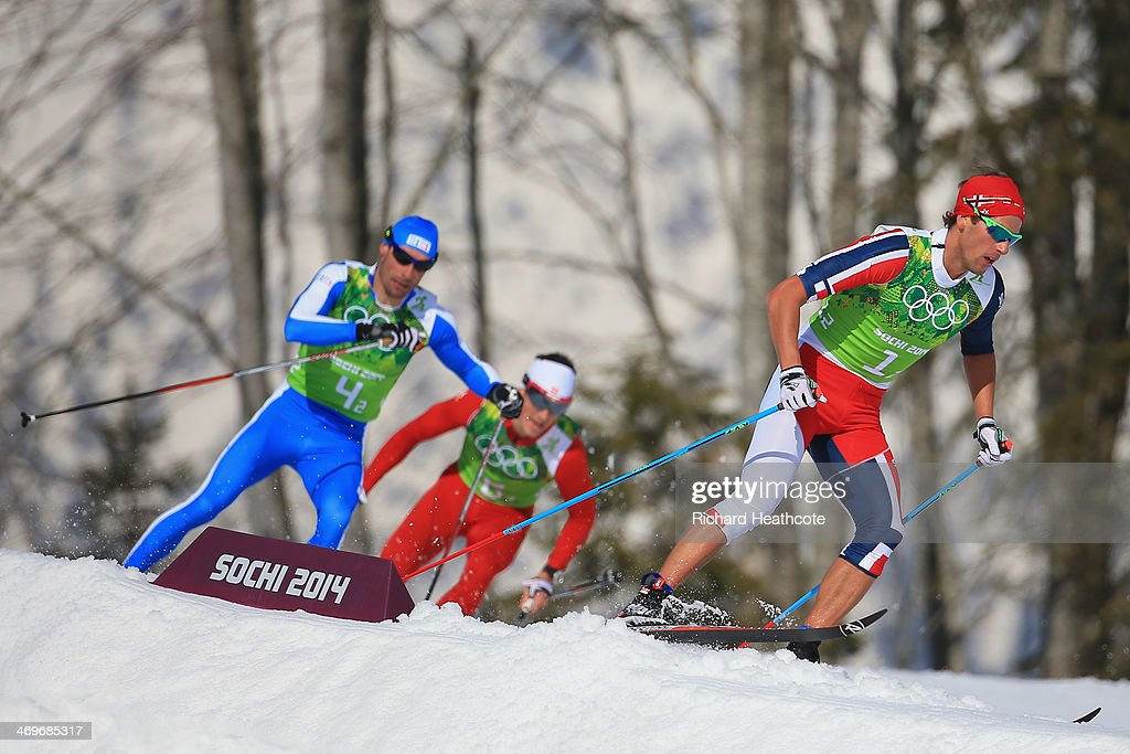 <a gi-track='captionPersonalityLinkClicked' href=/galleries/search?phrase=Eldar+Roenning&family=editorial&specificpeople=802581 ng-click='$event.stopPropagation()'>Eldar Roenning</a> (R) of Norway competes in the second leg of the Cross Country Men's 4 x 10 km Relay during day nine of the Sochi 2014 Winter Olympics at Laura Cross-country Ski & Biathlon Center on February 16, 2014 in Sochi, Russia.