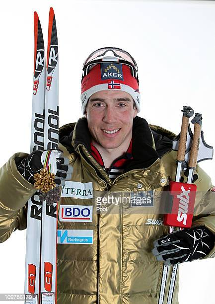 Eldar Roenning of Norway poses with the gold medal won in the Men's Cross Country 4x10km Relay race during the FIS Nordic World Ski Championships at...
