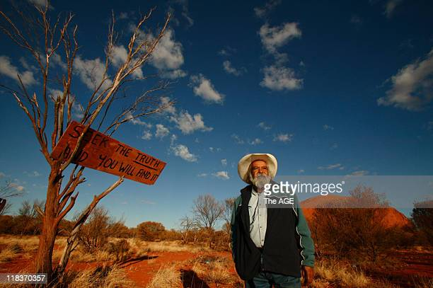 Elder Bob Randall and a mysterious sign that appeared outside Mutitjulu with Uluru in the background exact date unknown circa June 2008