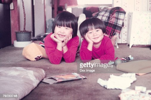 Elder sister and younger brother at home : Stock Photo