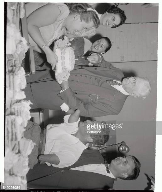 Elder statesman Bernard Baruch who'll be eightyfour Thursday cuts a cake held by Hazel Bonhin Jr as he attends a prebirthday party given him at...