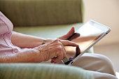 Elderley woman using tablet computer