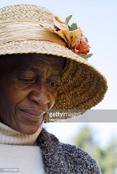 Elderly African woman reminiscing