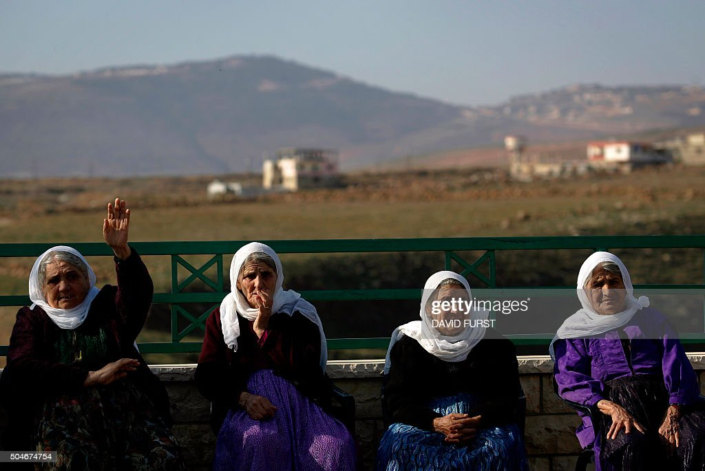 Elderly Arab women watch a demonstration against an ...