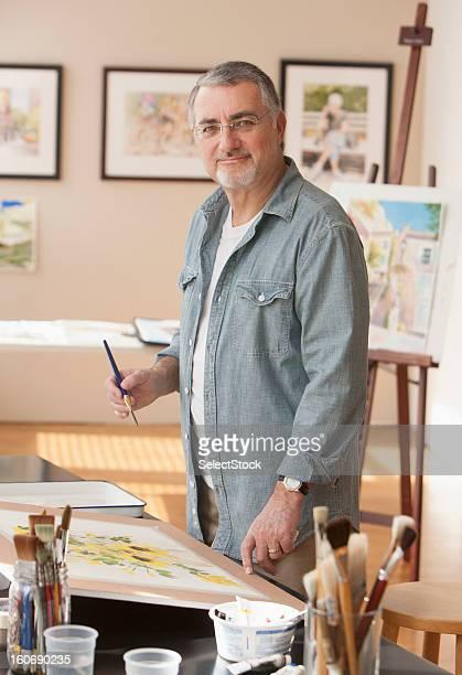 Elderly artist working at home