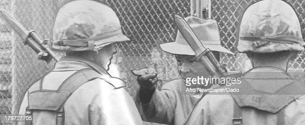 Elderly Baltimore resident confronts soldiers during riot so he can go get cigarettes Baltimore Maryland April 13 1968