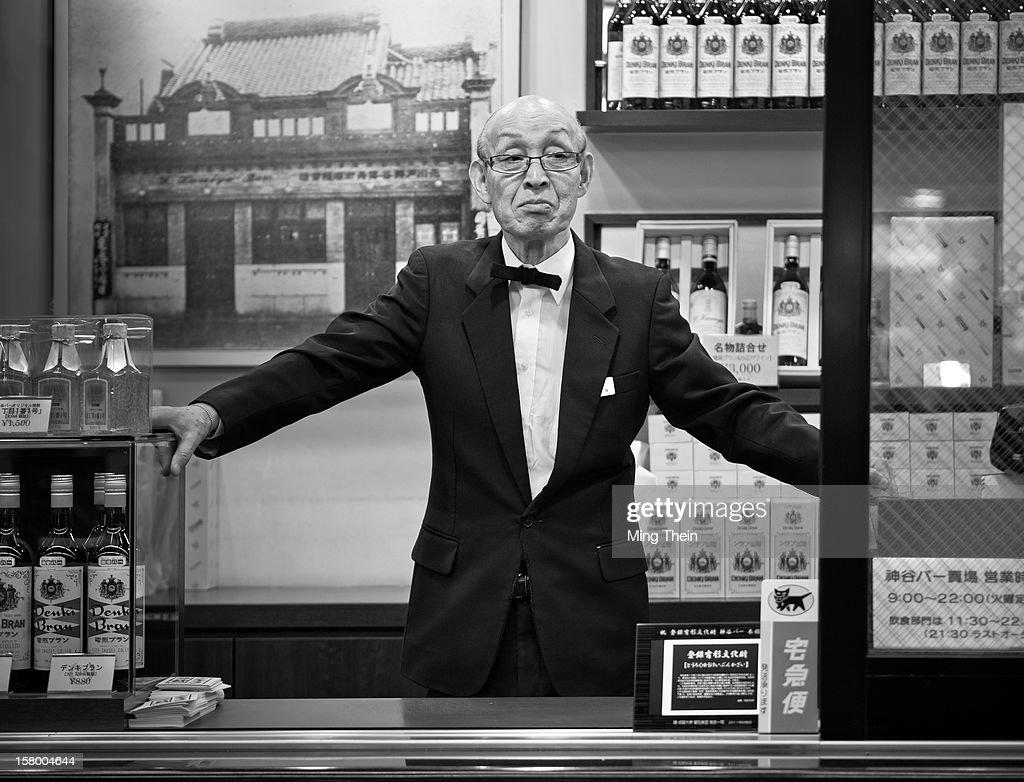Elderly bartender wearing a bow tie in Asakusa Tokyo in B&W