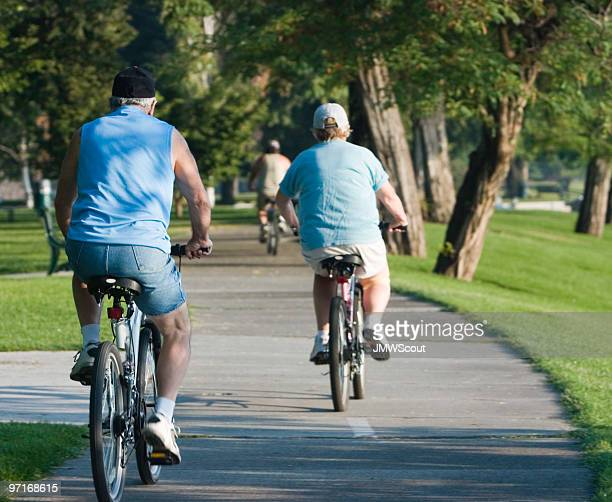 Elderly bicyclists on trail