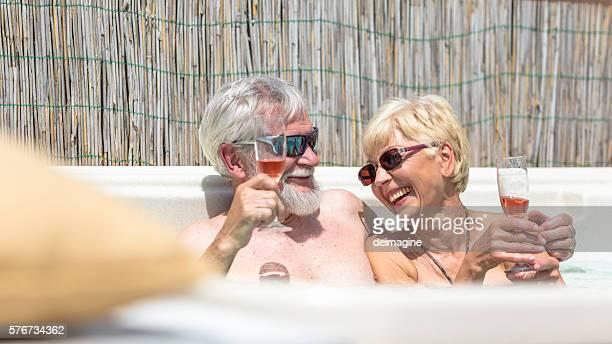 Elderly couple are enjoying in the whirlpool