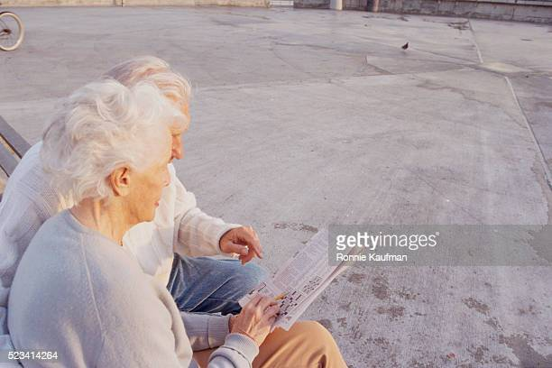 Elderly Couple Completing Crossword Puzzle