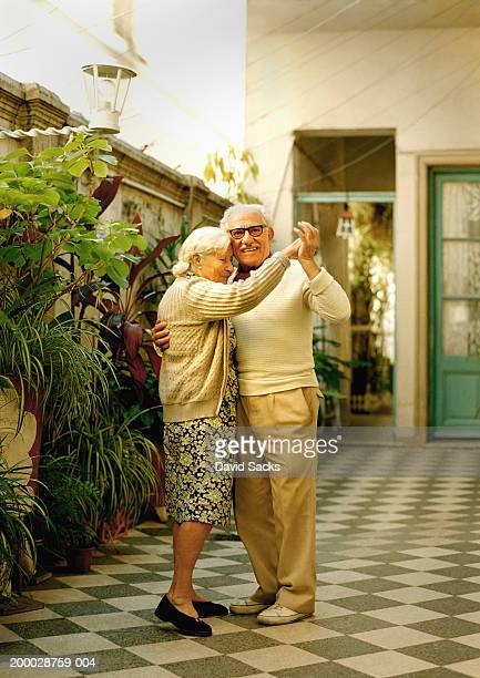 Elderly couple dancing, portrait