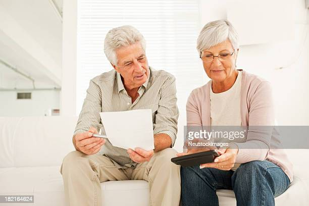 Elderly couple discussing budget