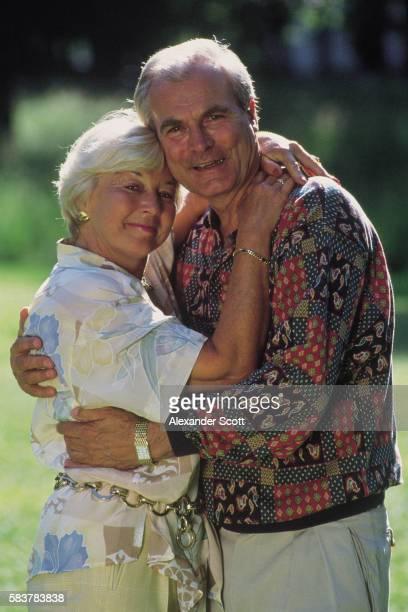 Elderly couple hugging each other, medium full shot
