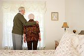 Elderly couple in their bedroom