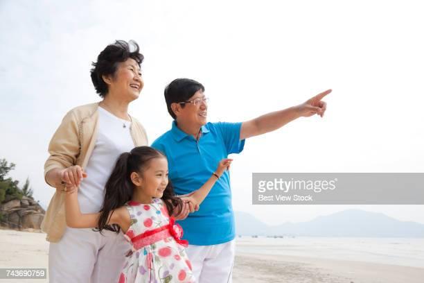 Elderly couple little girl in the seaside resort