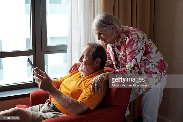 Elderly couple looking at ipad