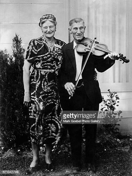 Elderly couple man playing violin mid to late 1920s