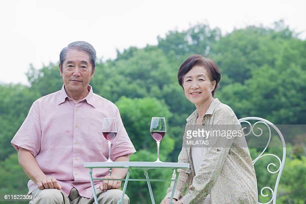 Elderly couple of Japanese drinking wine
