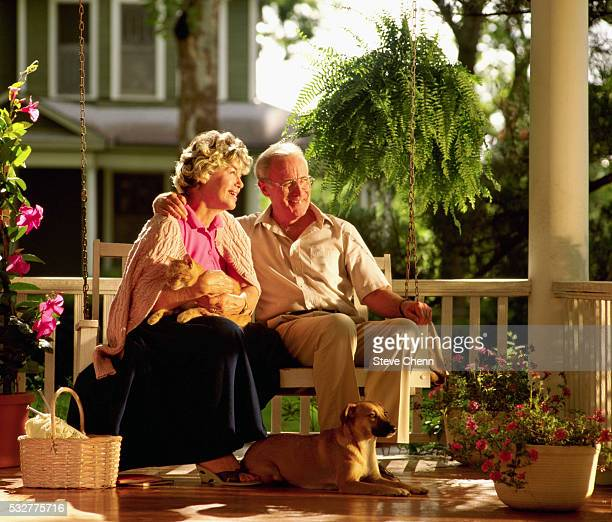 Elderly Couple on Porch Swing