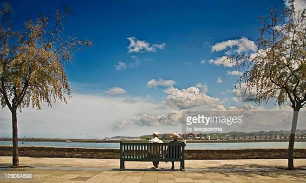 Elderly couple sitting on bench