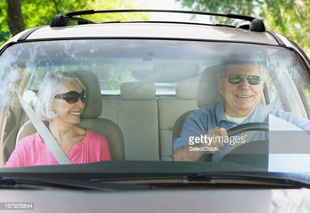 Elderly couple taking road trip