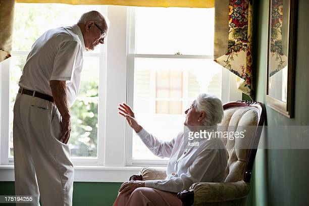 Elderly couple talking at home