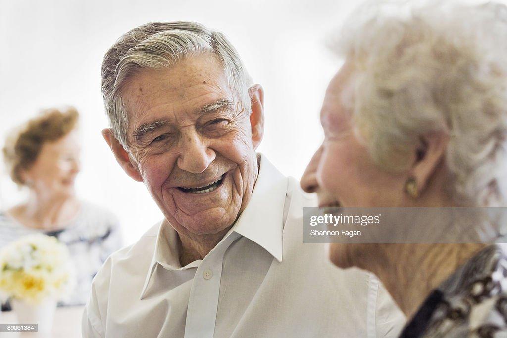 Elderly Couple Talking in Nursing Home : Stock Photo