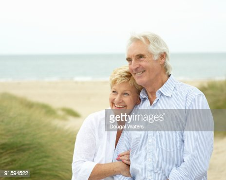 Elderly couple together at beach. : Stock Photo